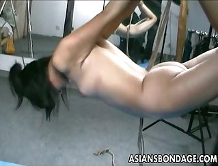 Big flower in skinned chick on an Asian bondage porn
