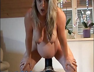 Blonde tgirl fed her fellows pregnant pussy with dildo