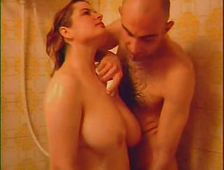 August plays with her tits