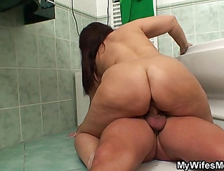 Busty babe getting her tits filled with black cock after riding on dick