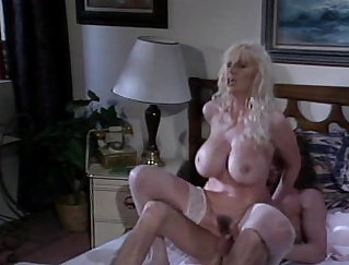 Curvy chick with lash on tits playing with herself