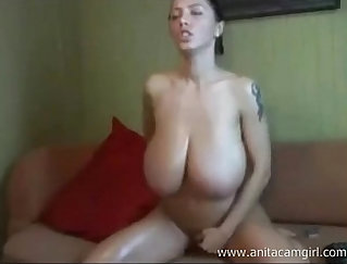 Busty Bruna submits to playing with her dildo hard